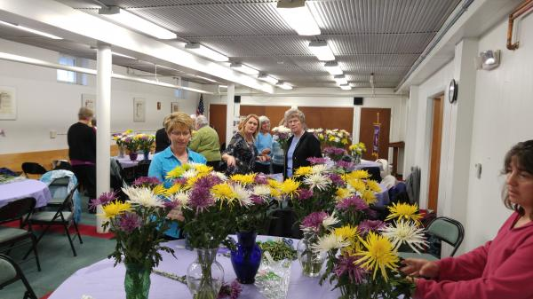 Court St Monica members gathered on 5/7/16 with guests from three other courts for their First Saturday celebration.  The day started with the Rosary and Mass.  Members enjoyed a light breakfast, then spent time arranging flowers from the court's Mothers Day fundraiser for display on the altar.  The event concluded with a May Crowning.