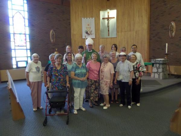 CDA members pose with Bishop Coyne after Mass at St Norbert on 8/27/16.