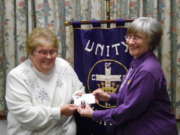 Mary Ainsworth, Vice Regent, is receiving her 50 year membership pin and certificate from Doris Voyer, Regent, at the 4/7/16 meeting.