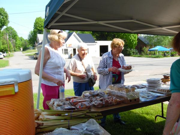 5/28/16 Josh Lussier, Helen Renaud and Jeannine Young prepare the table for our annual bake sale held during the Hardwick Spring Festival.