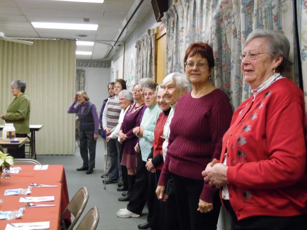12/1/16 CDA members line up at the Advent Party.